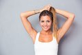 Happy Cute Girl Holding Her Ponytail Royalty Free Stock Image - 57305936