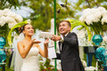 The Newlyweds Are Looking On The Flying Butterfly. Stock Photo - 57324430