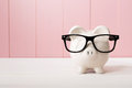 Piggy Bank With Glasses Over Pink Wooden Wall Royalty Free Stock Images - 57327809