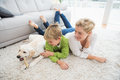 Happy Mother And Son With Puppy Royalty Free Stock Photo - 57355945