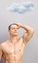 Young Man Taking Shower Under A Raining Cloud Royalty Free Stock Image - 57356606