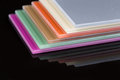 A Stack Of Colored Glass On A Black Background Stock Photography - 57367342
