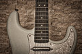 Electric Guitar Against Stone Textured Wall Stock Image - 57420001