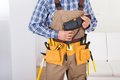 Man Wearing Tool Belt At Home Royalty Free Stock Photo - 57426025