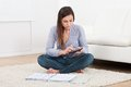 Woman Calculating Home Finances On Rug Stock Images - 57426554