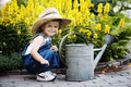 Little Boy With Watering Can In Summer Park Royalty Free Stock Photos - 57434808