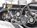 Dashboard And Steering Wheel In Interior Of British Classic Sport Car Isolated On White Background Royalty Free Stock Photos - 57493598