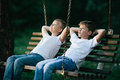 Little Boys Dreaming On Swing Royalty Free Stock Photography - 57494657