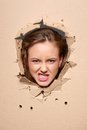 Displeased Girl Peeping Through Hole In Paper Stock Photo - 57496670