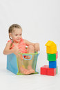The Girl Got Into Box From Under Blocks Royalty Free Stock Photography - 57497057