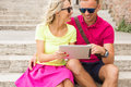 Couple Using Tablet Computer Royalty Free Stock Photo - 57500415