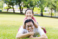 Father And Little Girl Lying On The Grass Royalty Free Stock Images - 57505569