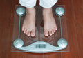 Woman Standing On Digital Weighing Apparatus,healthy Stock Photo - 57528990