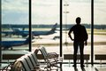 Silhouette Of A Man Waiting To Board A Flight In Royalty Free Stock Photo - 57550795