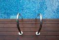 Chrome Ladder Into Swimming Pool Stock Photos - 57556193