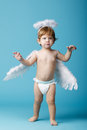 Little Angel On Blue Background Royalty Free Stock Photography - 57564377