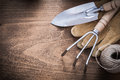 Metal Hand Spade Rake Brown Leather Gardening Gloves And Hank Of Stock Photography - 57567392