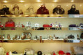 Showcase With Shoes And Bags. Royalty Free Stock Images - 57589159