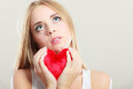 Sad Unhappy Woman Holding Red Heart Pillow Royalty Free Stock Image - 57590736