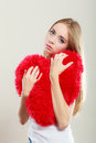 Sad Unhappy Woman Holding Red Heart Pillow Stock Images - 57590794