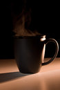 Steaming Black Bistro-style Mug Royalty Free Stock Images - 57595679