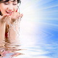 Pretty Woman Refreshing The Face Royalty Free Stock Image - 5761826