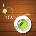A Cup Of Hot Green Tea And Tea Bag With Steam Stock Photo - 57606830