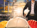 Engineering Man With White Safety Helmet Standing In Front Of Oi Royalty Free Stock Image - 57612276
