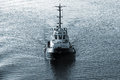 Tug Boat Underway, Front View, Dark Blue Tone Stock Photography - 57614872