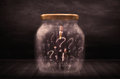 Businessman Locked Into A Jar With Question Marks Concept Stock Image - 57629661