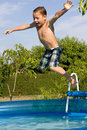 Little Boy Bathes In Pool Royalty Free Stock Photo - 57650815