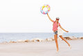 Beach Woman Happy And Colorful Wearing Sunglasses And Beach Hat Having Summer Fun During Travel Holidays Vacation Stock Photography - 57665982