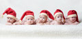 Babies With Santa Hats On Bright Background Stock Photography - 57675962