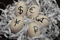 Eggs With Currency Signs Stock Image - 57678611