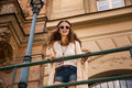 Longhaired Boho Chic With Sunglasses Near Old Town Streetlight Royalty Free Stock Photo - 57680475