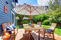 Picture Perfect Back Deck With Covered Seating. Royalty Free Stock Photos - 57712208
