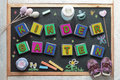 Blackboard In A Kindergarten Classroom And Some Baby Stuff. Stock Photo - 57713700