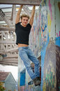 Handsome Blond Young Man Hanging From Concrete Structure Stock Image - 57731931