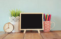 Blackboard, Stack Of Colorful Pencils And Clock. Back To School Concept Royalty Free Stock Images - 57736899