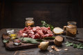 Raw Ingredients For Goulash Or Stew Raw Meat Herbs Spices On Old Cutting Board On Rustic Wooden Background Stock Photography - 57738462
