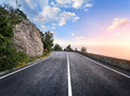 Asphalt Road In Summer Forest At Sunset. Crimean Mountains Stock Images - 57750814