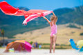 Little Girl With Beach Towel During Tropical Royalty Free Stock Photography - 57751687