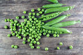 Pod Of Green Peas On Wood Royalty Free Stock Photography - 57787897