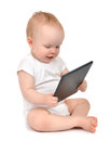 Infant Child Baby Toddler Sitting And Typing Digital Tablet Mobi Stock Photo - 57813580