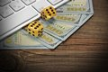 Computer Keyboard, Gaming Dices And Dollar Cash On Wood Backgrou Stock Photo - 57813640