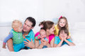 Big Family With Kids In Bed Royalty Free Stock Photos - 57824688
