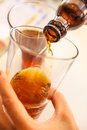 Pouring Beer From Bottle Into Mug Glass Royalty Free Stock Photo - 57842455