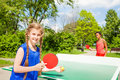Two Happy Girls Playing Ping Pong Outside Royalty Free Stock Images - 57845579