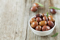 Fresh Olives In White Bowl On Wooden Table Royalty Free Stock Images - 57855959