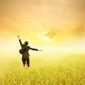 Business Woman Jumping In Yellow Rice Fields And Sunset On Success Day Stock Photo - 57891980